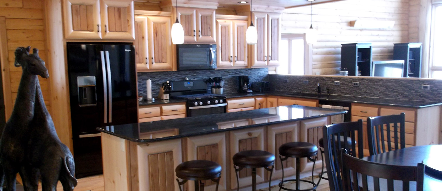 Log home kitchen with granite countertops
